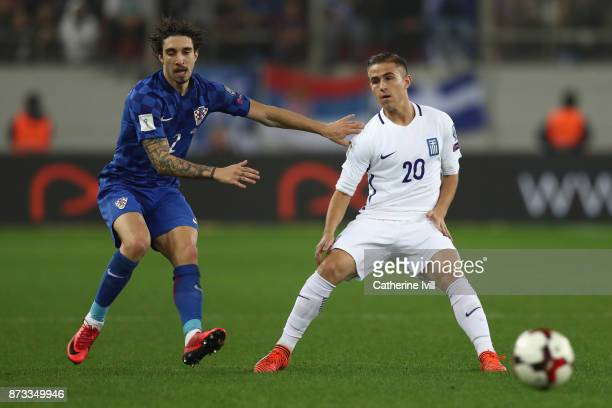 Dimitiov Pelkas of Greece and Sime Vrsaljko of Croatia in action during the FIFA 2018 World Cup Qualifier PlayOff Second Leg between Greece and...