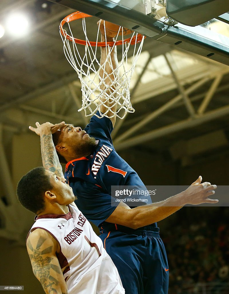 Dimitri Batten #1 of the Boston College Eagles fouls Justin Anderson #1 of the Virginia Cavaliers on his way to the basket in the second half during the game at Conte Forum on January 17, 2015 in Chestnut Hill, Massachusetts.