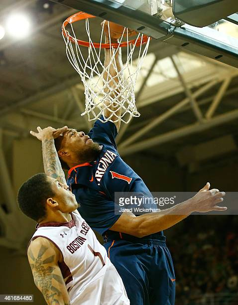Dimitri Batten of the Boston College Eagles fouls Justin Anderson of the Virginia Cavaliers on his way to the basket in the second half during the...
