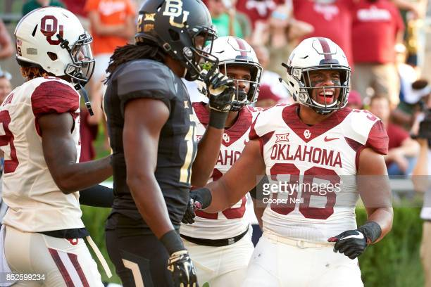 Dimitri Flowers of the Oklahoma Sooners celebrates after scoring on a 52yard touchdown reception against the Baylor Bears during the first half at...