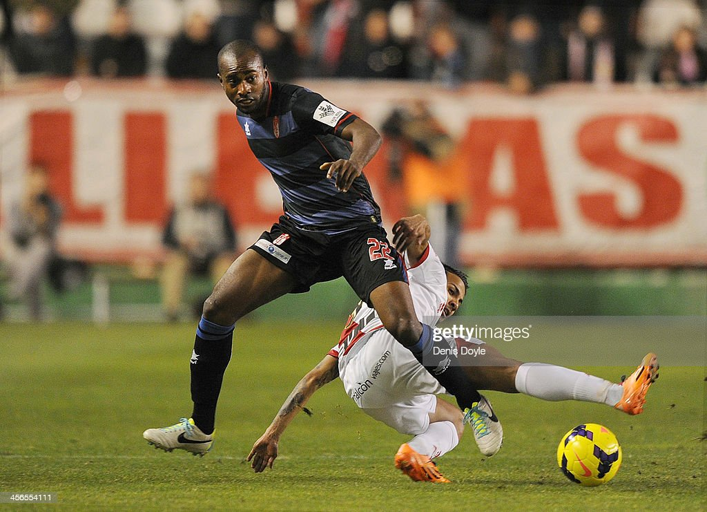 Dimitri Foulquier of Granada CF (L) battles for the ball against <a gi-track='captionPersonalityLinkClicked' href=/galleries/search?phrase=Jonathan+Viera&family=editorial&specificpeople=9632736 ng-click='$event.stopPropagation()'>Jonathan Viera</a> of Rayo Vallecano de Madrid during the La Liga match between Rayo Vallecano de Madrid and Granada CF at Teresa Rivero stadium on December 14, 2013 in Madrid, Spain.