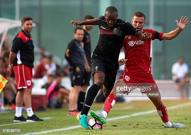 Dimitri Foulquier of Granada is tackled by Gary O'Neil of Bristol City during the friendly match between Granada CF and Bristol City at Pinatar Arena...