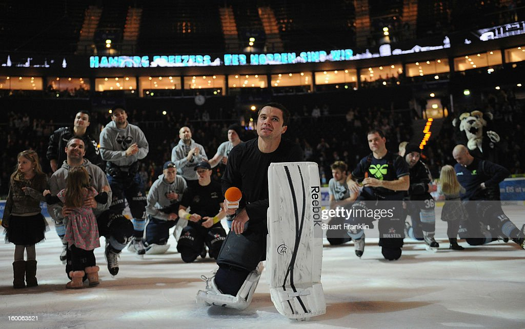 Dimitri Kotschnew of Hamburg leads the player celebration at the end of the DEL game between Hamburg Freezers and Thomas Sabo Ice Tigers at O2 World on January 25, 2013 in Hamburg, Germany.