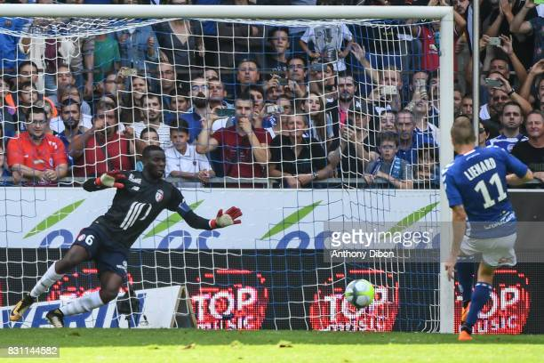Dimitri Lienard of Strasbourg scores a penalty against Ibrahim Amadou who replaced Mike Maignan because after he received a red card during the Ligue...