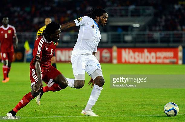 Dimitri Magnokele Bissiki of Congo vies with Dieumerci Mbokani of Democratic Republic of the Congo during 2015 African Cup of Nations quarter final...