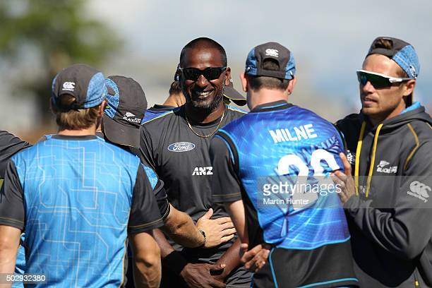 Dimitri Mascarenhas Black Caps bowling coach shares a laugh with team mates prior to the start of the third One Day International match between New...