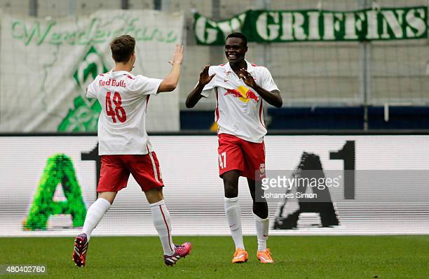 Dimitri Oberlin of Salzburg celebrates with team mate Michael Brandner after scoring his team's first goal during the preseason match for the 3rd...