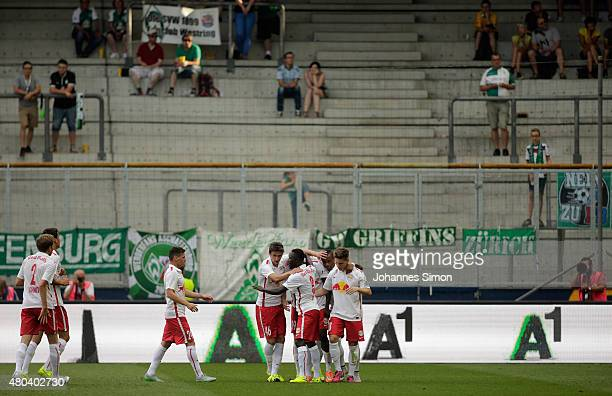 Dimitri Oberlin of Salzburg celebrates with team mates after scoring hios team's first goal during the preseason match for the 3rd place between FC...
