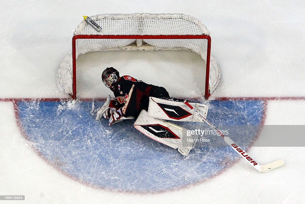 Dimitri Paetzold, goaltender of Hannover lies on the ice during the DEL match between Hannover Scorpions and Straubing Tigers at TUI Arena on January 13, 2013 in Hanover, Germany.