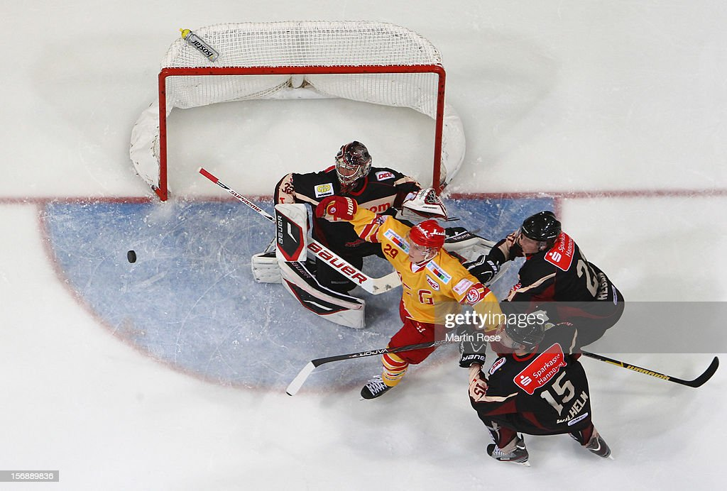 <a gi-track='captionPersonalityLinkClicked' href=/galleries/search?phrase=Dimitri+Paetzold&family=editorial&specificpeople=851119 ng-click='$event.stopPropagation()'>Dimitri Paetzold</a> (C), goaltender of Hannover makes a save on Alexander Preibisch (#29) of Duesseldorf during the DEL match between Hannover Scorpions and Duesseldorfer EG at TUI Arena on November 23, 2012 in Hanover, Germany.