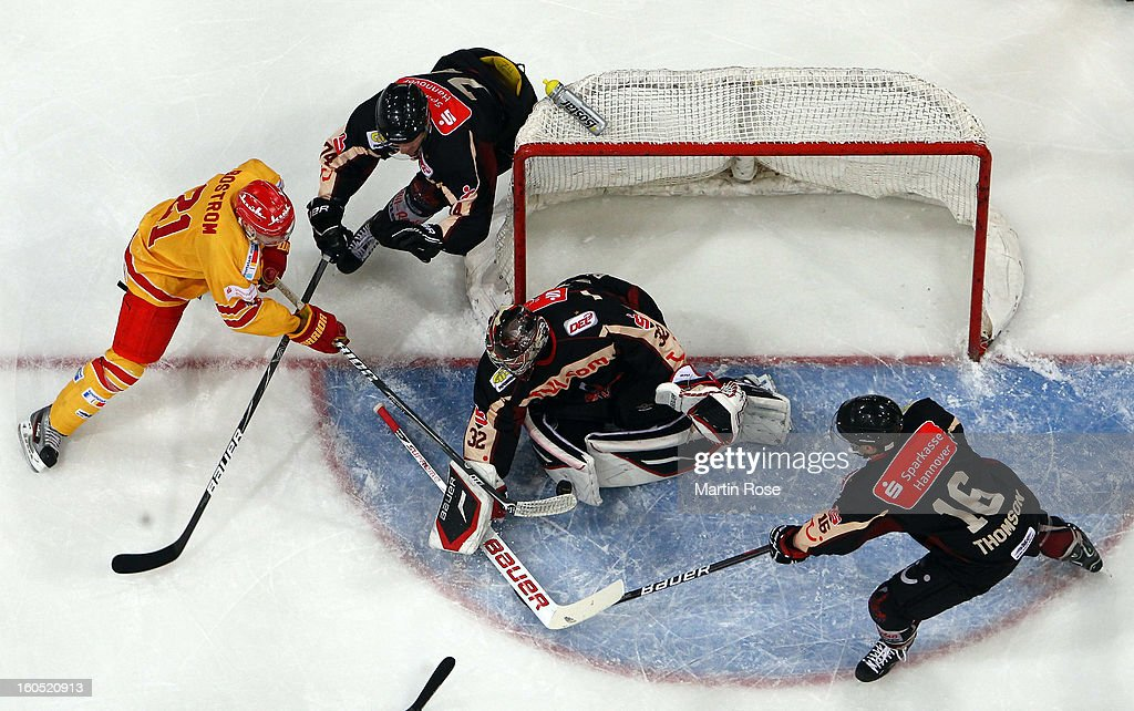 <a gi-track='captionPersonalityLinkClicked' href=/galleries/search?phrase=Dimitri+Paetzold&family=editorial&specificpeople=851119 ng-click='$event.stopPropagation()'>Dimitri Paetzold</a> (C), goaltender of Hannover saves the shot of Justin Bastrom (#21) of Duesseldorf during the DEL match between Hannover Scorpions and Duesseldorfer EG at TUI Arena on February 1, 2013 in Hanover, Germany.
