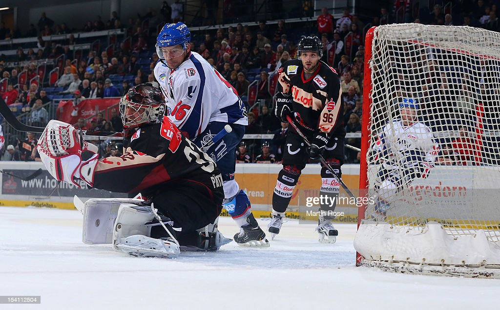 Dimitri Paetzold goaltender of Hannover saves the shot of Yannic Seidenberg of Mannheim during the DEL match between Hannover Scorpions and Aadler...