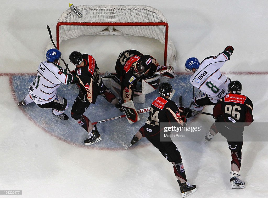 Dimitri Patzold, goaltender of Hannover covers the puck during the DEL match between Hannover Scorpions and Augsburger Panther at TUI Arena at TUI Arena on January 9, 2013 in Hanover, Germany.