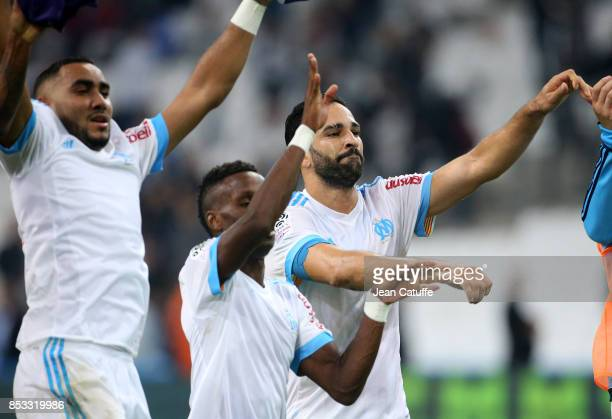 Dimitri Payet Adil Rami of OM celebrate the victory following the French Ligue 1 match between Olympique de Marseille and Toulouse FC at Stade...