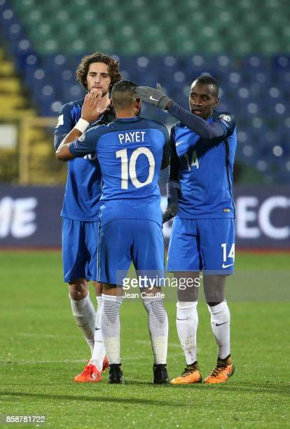 Dimitri Payet Adrien Rabiot Blaise Matuidi of France celebrate the victory following the FIFA 2018 World Cup Qualifier between Bulgaria and France at...
