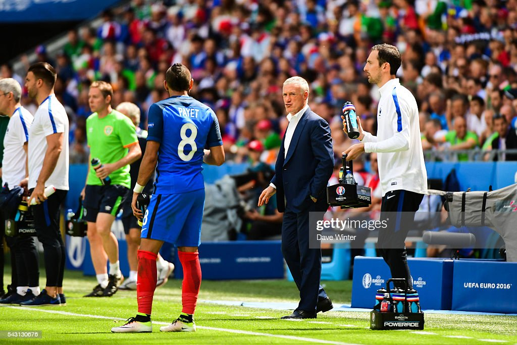 Dimitri Payet and Didier Deschamps head coach of France during the European Championship match Round of 16 between France and Republic of Ireland at Stade des Lumieres on June 26, 2016 in Lyon, France.