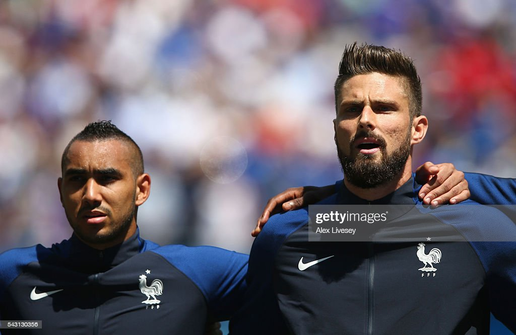 <a gi-track='captionPersonalityLinkClicked' href=/galleries/search?phrase=Dimitri+Payet&family=editorial&specificpeople=2137146 ng-click='$event.stopPropagation()'>Dimitri Payet</a> (L) and <a gi-track='captionPersonalityLinkClicked' href=/galleries/search?phrase=Olivier+Giroud&family=editorial&specificpeople=5678034 ng-click='$event.stopPropagation()'>Olivier Giroud</a> (R) of France line up for the national anthem prior to the UEFA EURO 2016 round of 16 match between France and Republic of Ireland at Stade des Lumieres on June 26, 2016 in Lyon, France.