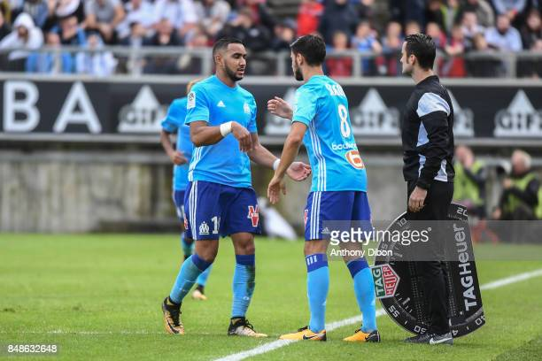 Dimitri Payet is replaced by Morgan Sanson of Marseille during the Ligue 1 match between Amiens SC and Olympique Marseille at Stade de la Licorne on...