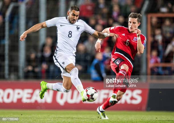 Dimitri Payet of France and Chris Philipps of Luxembourg in action during the FIFA 2018 World Cup Qualifier between Luxembourg and France at Stade...