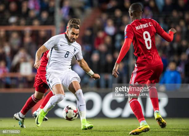 Dimitri Payet of France and Christopher Martins of Luxembourg in action during the FIFA 2018 World Cup Qualifier between Luxembourg and France at...