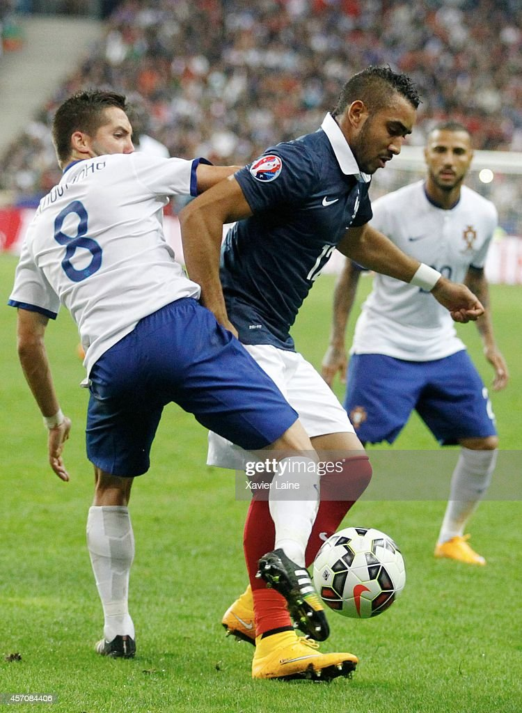 <a gi-track='captionPersonalityLinkClicked' href=/galleries/search?phrase=Dimitri+Payet&family=editorial&specificpeople=2137146 ng-click='$event.stopPropagation()'>Dimitri Payet</a> of France and Joao Moutinho of Portugal during the International Friendly Soccer match between France and Portugal at Stade de France on october 11, 2014 in Paris, France.