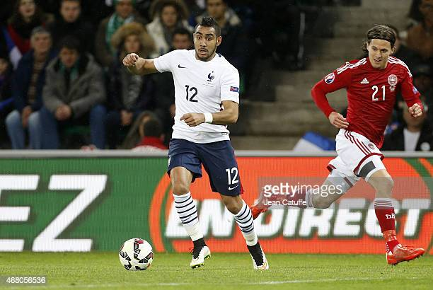 Dimitri Payet of France and Lasse Vibe of Denmark in action during the international friendly match between France and Denmark at Stade...