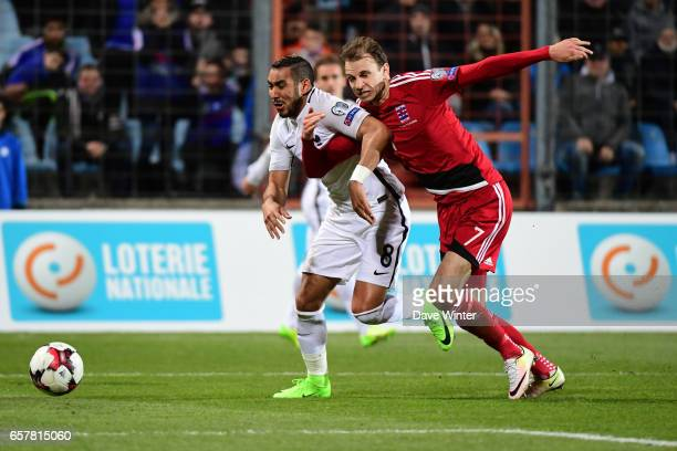 Dimitri Payet of France and Maurice Deville of Luxembourg during the FIFA World Cup 2018 qualifying match between Luxembourg and France on March 25...