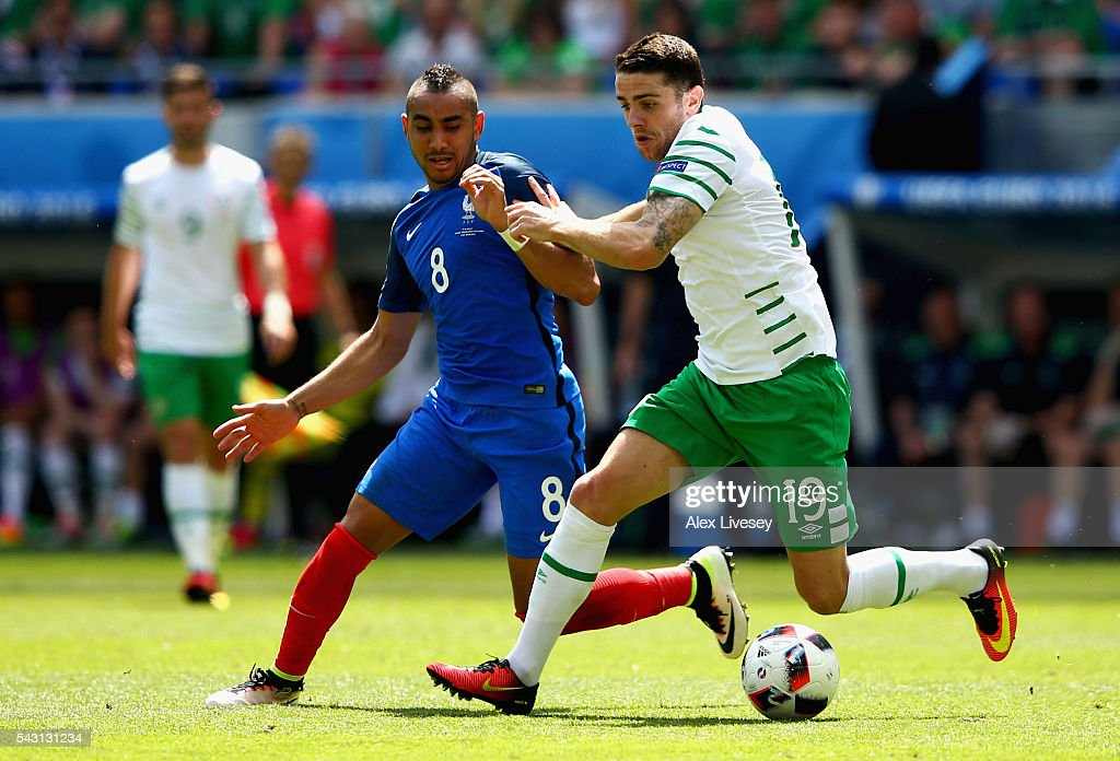 <a gi-track='captionPersonalityLinkClicked' href=/galleries/search?phrase=Dimitri+Payet&family=editorial&specificpeople=2137146 ng-click='$event.stopPropagation()'>Dimitri Payet</a> of France and <a gi-track='captionPersonalityLinkClicked' href=/galleries/search?phrase=Robbie+Brady&family=editorial&specificpeople=9028769 ng-click='$event.stopPropagation()'>Robbie Brady</a> of Republic of Ireland compete for the ball during the UEFA EURO 2016 round of 16 match between France and Republic of Ireland at Stade des Lumieres on June 26, 2016 in Lyon, France.