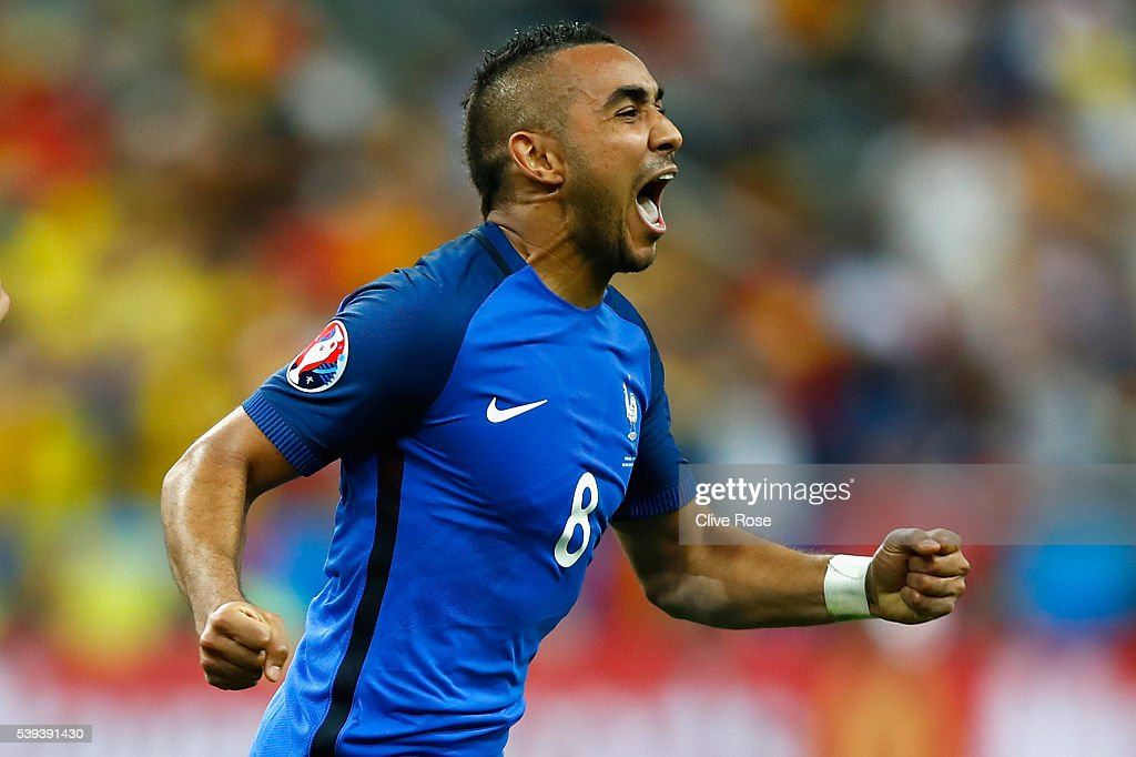 Dimitri Payet of France celebrates scoring his team's second goal during the UEFA Euro 2016 Group A match between France and Romania at Stade de...