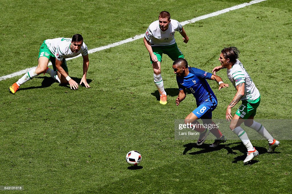 <a gi-track='captionPersonalityLinkClicked' href=/galleries/search?phrase=Dimitri+Payet&family=editorial&specificpeople=2137146 ng-click='$event.stopPropagation()'>Dimitri Payet</a> of France competes for the ball against Ireland defense during the UEFA EURO 2016 round of 16 match between France and Republic of Ireland at Stade des Lumieres on June 26, 2016 in Lyon, France.