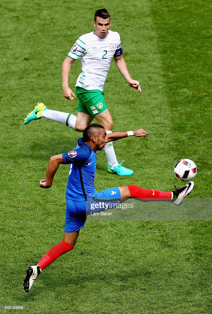 Dimitri Payet of France controls the ball under pressure of Seamus Coleman of Republic of Ireland during the UEFA EURO 2016 round of 16 match between France and Republic of Ireland at Stade des Lumieres on June 26, 2016 in Lyon, France.