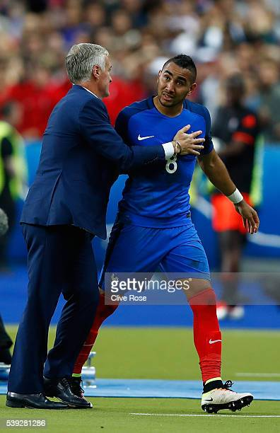 Dimitri Payet of France high fives with Didier Deschamps manager of France as he is substituted during the UEFA Euro 2016 Group A match between...