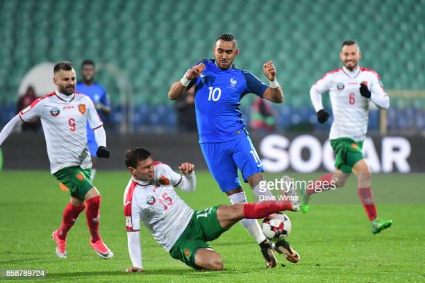 Dimitri Payet of France is blocked by Vasil Bozhikov of Bulgaria during the Fifa 2018 World Cup qualifying match between Bulgaria and France on...