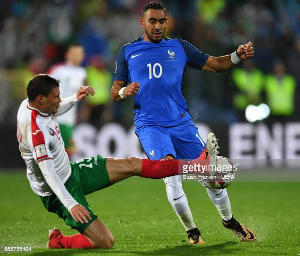 Dimitri Payet of France is challenged by Ivaylo Dimitrov of Bulgaria during the FIFA 2018 World Cup Qualifier between Bulgaria and France at on...