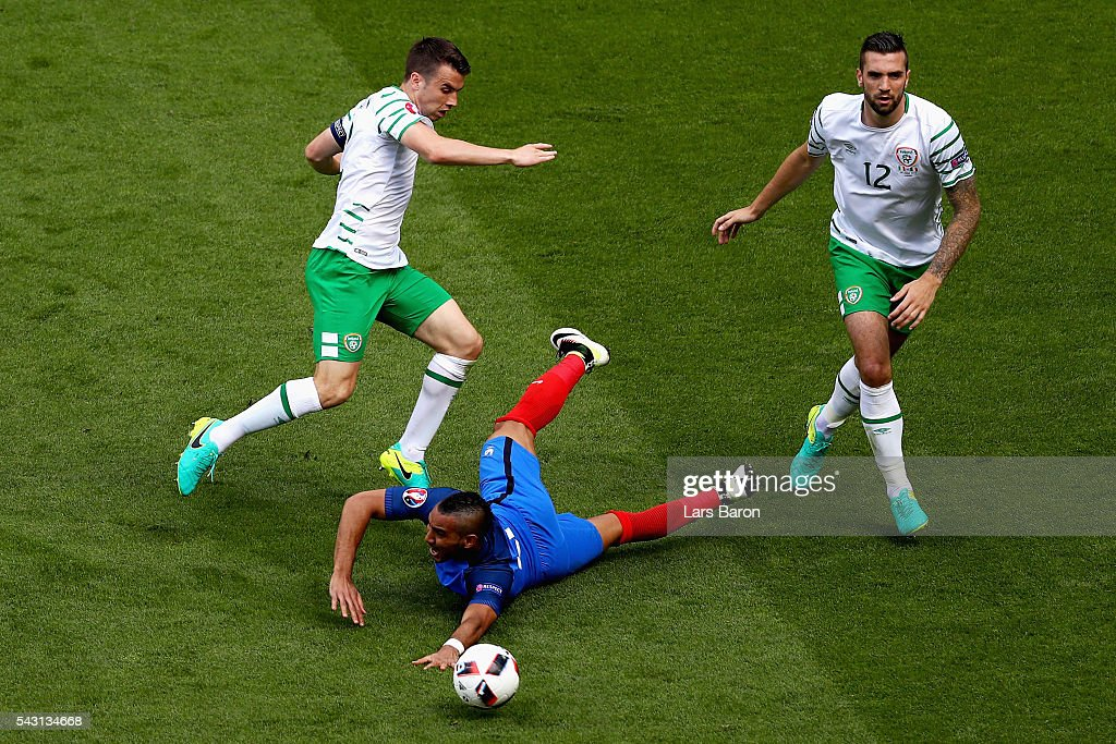 Dimitri Payet (C) of France is challenged by Seamus Coleman (L) and Shane Duffy (R) of Republic of Ireland during the UEFA EURO 2016 round of 16 match between France and Republic of Ireland at Stade des Lumieres on June 26, 2016 in Lyon, France.