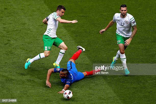 Dimitri Payet of France is challenged by Seamus Coleman and Shane Duffy of Republic of Ireland during the UEFA EURO 2016 round of 16 match between...