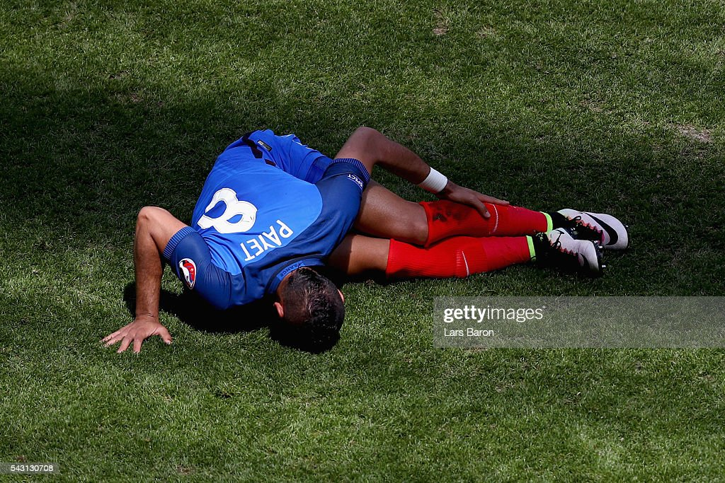 <a gi-track='captionPersonalityLinkClicked' href=/galleries/search?phrase=Dimitri+Payet&family=editorial&specificpeople=2137146 ng-click='$event.stopPropagation()'>Dimitri Payet</a> of France lies injured during the UEFA EURO 2016 round of 16 match between France and Republic of Ireland at Stade des Lumieres on June 26, 2016 in Lyon, France.