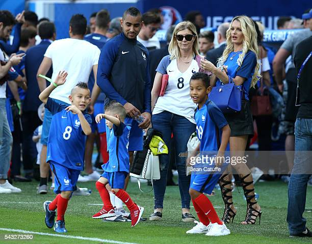 Dimitri Payet of France meets his wife Ludivine Payet and their sons Milan Payet and Noa Payet following the UEFA EURO 2016 round of 16 match between...