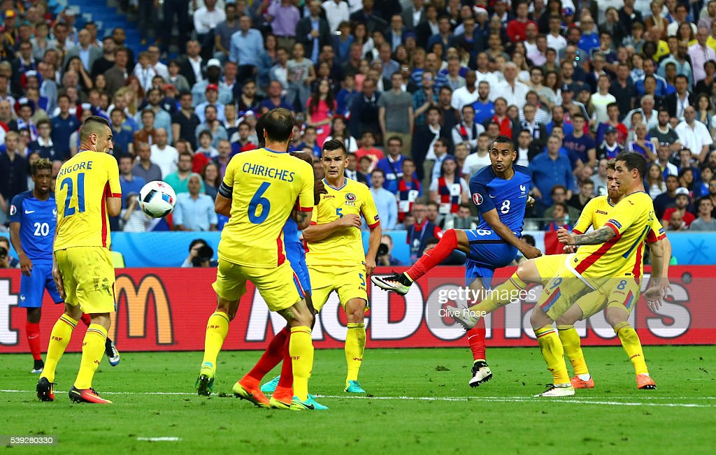 Dimitri Payet of France scores his team's second goal during the UEFA Euro 2016 Group A match between France and Romania at Stade de France on June 10, 2016 in Paris, France.