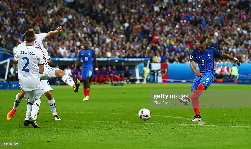 Dimitri Payet of France scores his team's third goal during the UEFA EURO 2016 quarter final match between France and Iceland at Stade de France on...