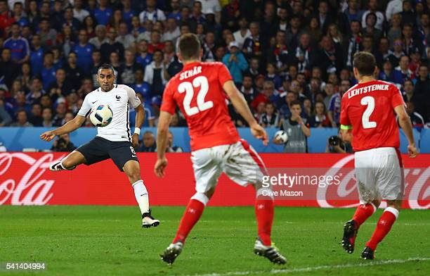 Dimitri Payet of France shoots at goal hitting the cross bar during the UEFA EURO 2016 Group A match between Switzerland and France at Stade...