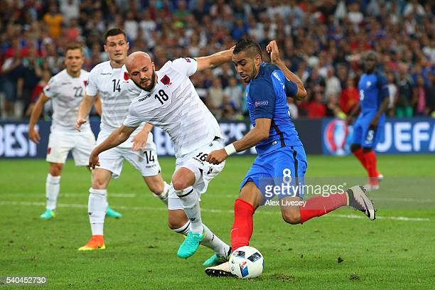 Dimitri Payet of France takes on Arlind Ajeti of Albania during the UEFA EURO 2016 Group A match between France and Albania at Stade Velodrome on...