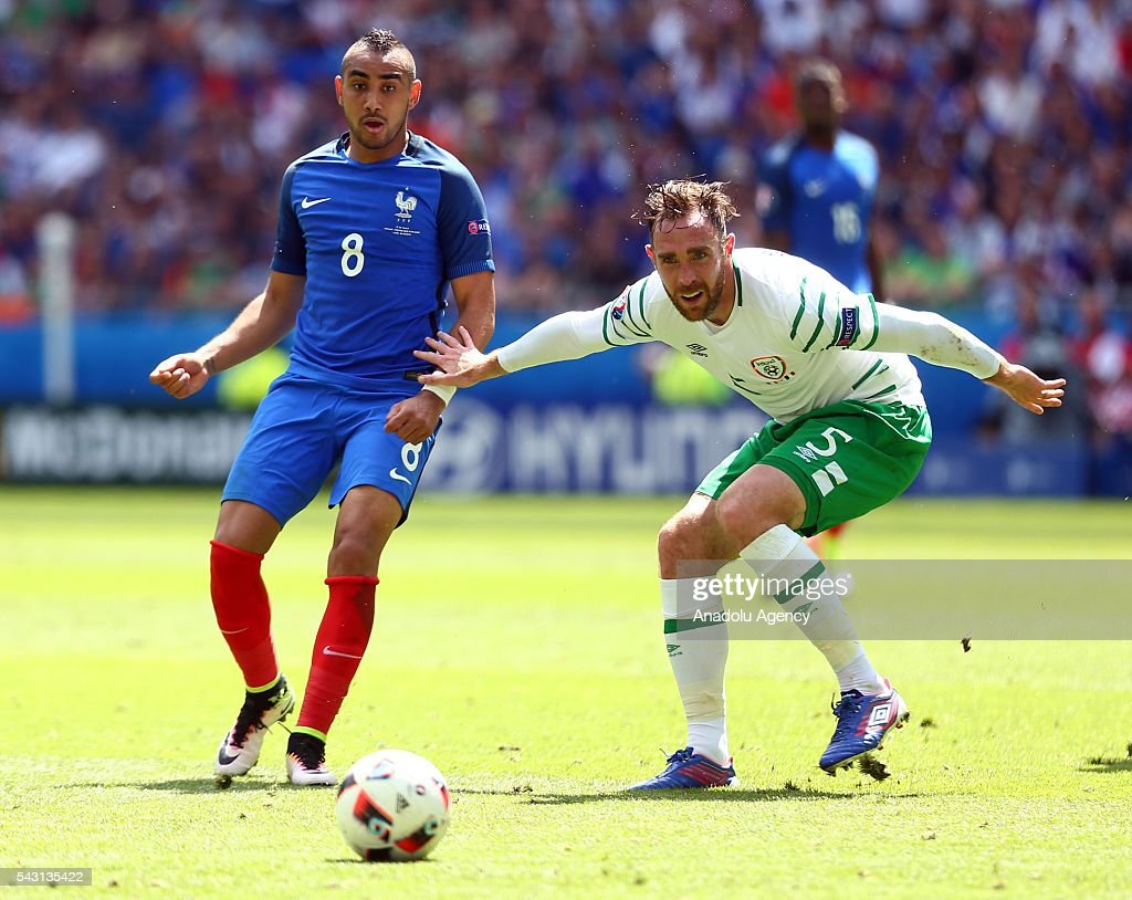 Dimitri Payet of France (L) vies with Richard Keogh of Ireland (R) during the UEFA Euro 2016 Round of 16 football match between France and Ireland at the Stade de Lyon in Lyon, France on June 26, 2016.