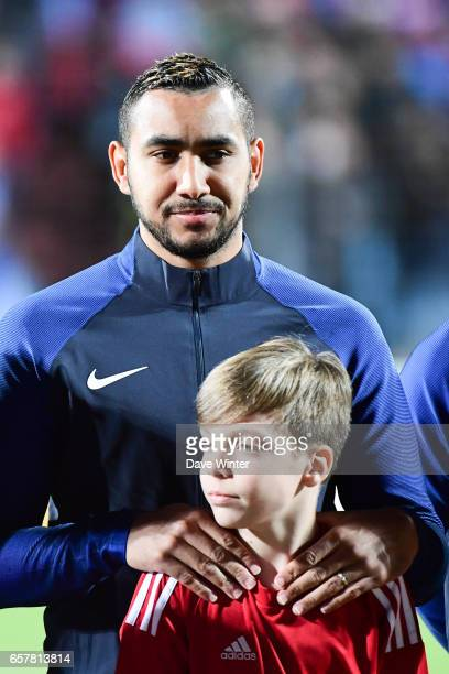 Dimitri Payet of France with a mascot during the FIFA World Cup 2018 qualifying match between Luxembourg and France on March 25 2017 in Luxembourg...