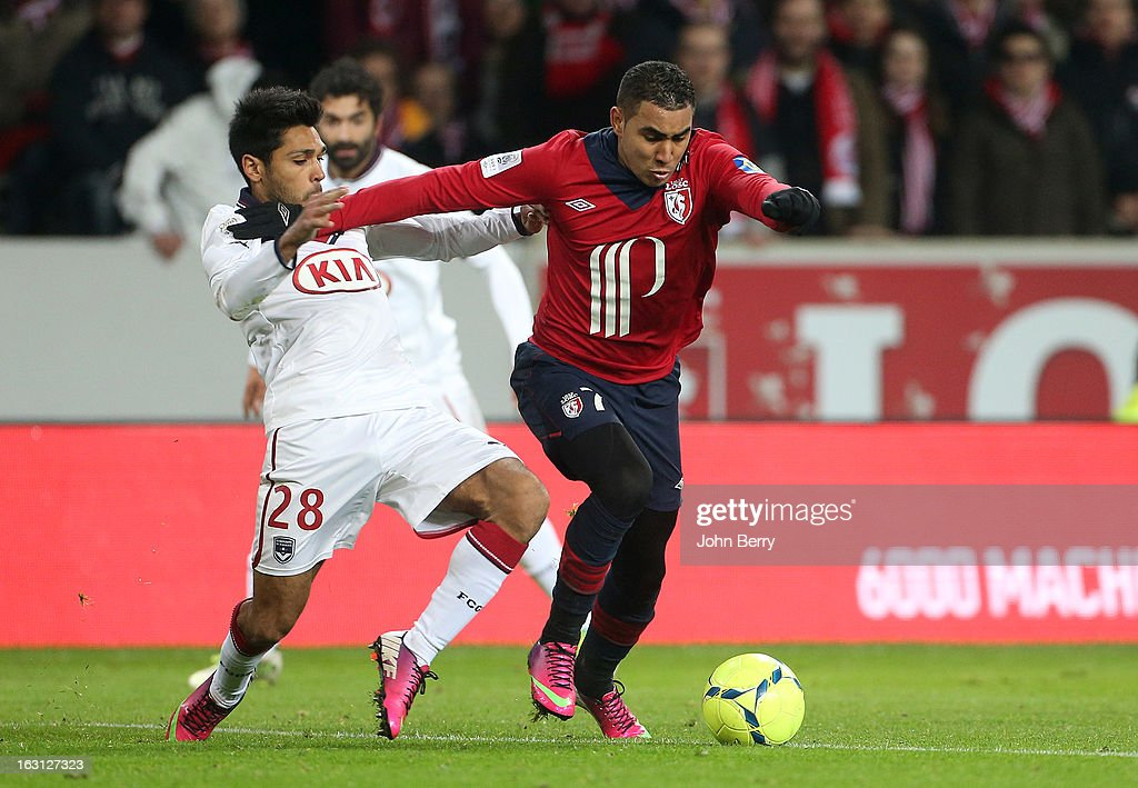 <a gi-track='captionPersonalityLinkClicked' href=/galleries/search?phrase=Dimitri+Payet&family=editorial&specificpeople=2137146 ng-click='$event.stopPropagation()'>Dimitri Payet</a> of Lille and <a gi-track='captionPersonalityLinkClicked' href=/galleries/search?phrase=Benoit+Tremoulinas&family=editorial&specificpeople=4530463 ng-click='$event.stopPropagation()'>Benoit Tremoulinas</a> of Bordeaux (L) in action during the french Ligue 1 match between Lille LOSC and FC Girondins de Bordeaux at the Grand Stade Lille Metropole on March 3, 2013 in Lille, France.