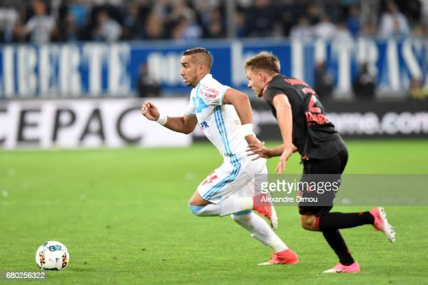 Dimitri Payet of Marseille and Arnaud Souquet of Nice during the Ligue 1 match between Olympique de Marseille and OGC Nice at Stade Velodrome on May...