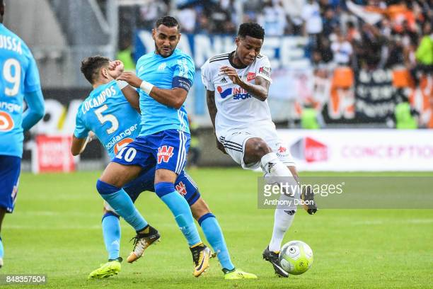 Dimitri Payet of Marseille and Bongani Zungu of Amiens during the Ligue 1 match between Amiens SC and Olympique Marseille at Stade de la Licorne on...