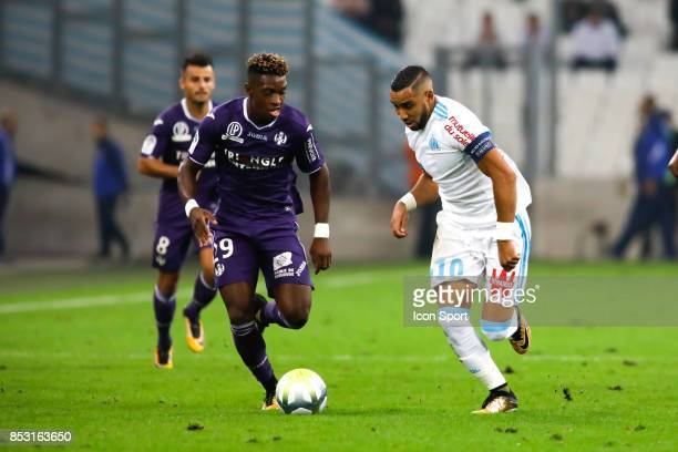 Dimitri Payet of Marseille and Jacques Francois Moubandje of Toulouse during the Ligue 1 match between Olympique Marseille and Toulouse at Stade...