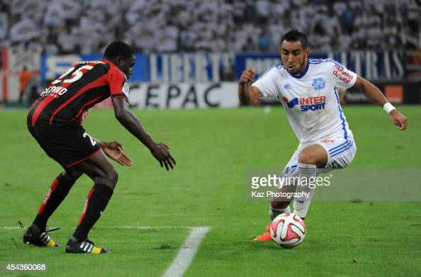Dimitri Payet of Marseille and Romain Genevois of Nice compete for the ball during the French Ligue 1 match between Olympique de Marseille and OGC...