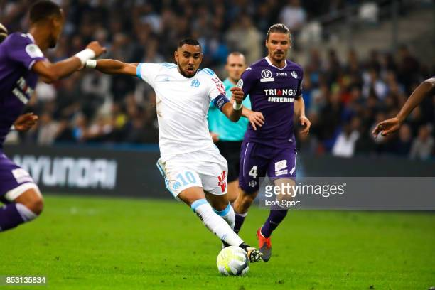 Dimitri Payet of Marseille and Yannick Cahuzac during the Ligue 1 match between Olympique Marseille and Toulouse at Stade Velodrome on September 24...